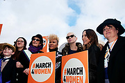 London March 4th 2017.Thousands of people marched across Tower Bridge in an event organised by Care International to highlight the inequality faced by women and girls around the world. Helen Pankhurst 3nd left descended from suffragettes Emily and Sylvia Pankhurst, Emeli Sandi , Annie Lennox and Mel C performed and led the march.