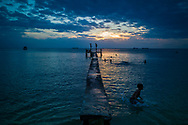 Carefree kids play at sunset on Long Beach, Phu Quoc Island, Kien Giang Province, Vietnam, Southeast Asia