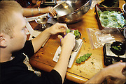 Workers processing, weighing and packaging medical marijuana at the San Francisco Cannabis Buyers Club in San Francisco, 1997.