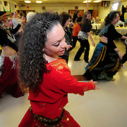4/5/09 -- BRUNSWICK, Maine. Professional belly dancer Nyiesha DeLima of Saco leads a local group of student dancers in a rhythmic motion routine as part of a Belly Dance Community food raising event at Bath Elks Lodge on Saturday.  The group is made up of women of all ages and skill levels. <br /> DeLima has danced in Las Vegas and on other national stages. She shared her time to help raise money for charity and provide inspiration for others.  Photo by Roger S. Duncan.