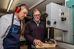Pictured: Willie Rennie was shown the safe way to work with a band saw by Charlie Taylor, co-founder and co-leader of the Men of Leith Mens Shed<br /><br />Scottish Liberal Democrat Leader Willie Rennie visited the The Men of Leith mens shed in Edinburgh today. The Men Of Leith Mens Shed  is a community project which focuses on bringing men together to tackle isolation, learn new skills and help the community..<br /><br />Ger Harley | EEm 19 November 2019