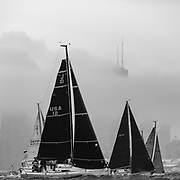 The J Class Division leaves Chicago in the background as they sail  away from the shores of Lake Michigan