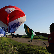 Hot Air balloon teams pack up after landing in rural Michigan near Battle Creek during the World Hot Air Ballooning Championships. Battle Creek, Michigan, USA. 21st August 2012. Photo Tim Clayton