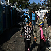MORIA, GREECE - JANUARY 22: Refugee children can be found milling around and playing in tents on the periphery of Moria camp on JANUARY 22, 2020 in Moria. According to The Guardian, current numbers say the encampment now holds 19,000 asylum-seekers. (Photo by Byron Smith/Getty Images)