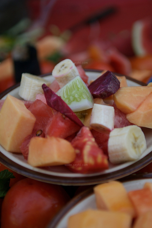 A plate of fruits and vegetables in Old Delhi.