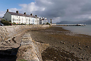 Terraced houses at Chapel Street Stryd y Cape, in the Welsh language, on the seafront of Beaumaris, on 3rd October 2021, in Beaumaris, Anglesey, Wales.