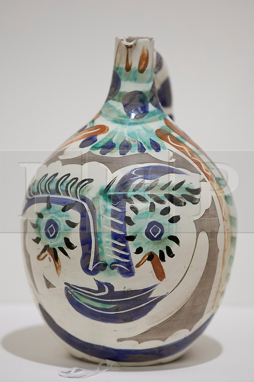 © Licensed to London News Pictures. 13/A Sotheby's employee holds 'Visage aux yeux rieurs' (1969) (est. GB£8,000-12,000) a earthenware clay pitcher by Pablo Picasso is seen at the press view for Sotheby's 'Prints and Multiples Sale' on New Bond Street in London today (13/09/2013). The auction, set to take place on the 17th of September, includes works by Munch, Rembrandt, Basquiat, Warhol and Picasso. Photo credit: Matt Cetti-Roberts/LNP