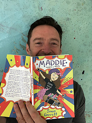 """Hugh Jackman releases a photo on Twitter with the following caption: """"""""Proud of my sister - who now adds author to her resume! Congrats Sonia Garrett on the debut of """"Maddie Makes A Movie"""". Great read ... especially for young adults. #maddiemakesamovie #reading"""""""". Photo Credit: Twitter *** No USA Distribution *** For Editorial Use Only *** Not to be Published in Books or Photo Books ***  Please note: Fees charged by the agency are for the agency's services only, and do not, nor are they intended to, convey to the user any ownership of Copyright or License in the material. The agency does not claim any ownership including but not limited to Copyright or License in the attached material. By publishing this material you expressly agree to indemnify and to hold the agency and its directors, shareholders and employees harmless from any loss, claims, damages, demands, expenses (including legal fees), or any causes of action or allegation against the agency arising out of or connected in any way with publication of the material."""