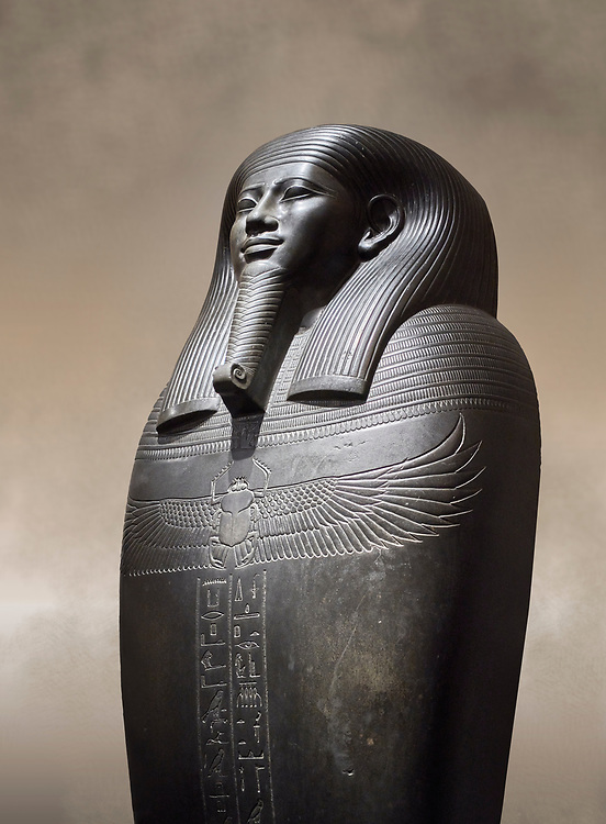 Ancient Egyptian greywacke sarcophagus of Vizier Gemenefherbak - late Period, 26th Dynasty (664-525BC). Egyptian Museum, Turin. <br /> <br /> Gemenefherbak was a vizier, minister, as indicated by a pendant picturing the goddess Maat hanging around his neck in the shadow of his beard. Despite the hardness of the greywacke stone the sarcophagus is made from, its makers have shown incredible skill creating a sarcophagus with intricate detail and a highly polished finish. .<br /> <br /> If you prefer to buy from our ALAMY PHOTO LIBRARY  Collection visit : https://www.alamy.com/portfolio/paul-williams-funkystock/ancient-egyptian-art-artefacts.html  . Type -   Turin   - into the LOWER SEARCH WITHIN GALLERY box. Refine search by adding background colour, subject etc<br /> <br /> Visit our ANCIENT WORLD PHOTO COLLECTIONS for more photos to download or buy as wall art prints https://funkystock.photoshelter.com/gallery-collection/Ancient-World-Art-Antiquities-Historic-Sites-Pictures-Images-of/C00006u26yqSkDOM