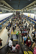Commuters inside Zhongxiao Fuxing MRT station on the Taipei Metro system.