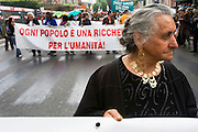 Santino Spinelli's mother on the demonstration against racism in Rome. Roma Gypsies victims of racism and discrimination, often forcibly evicted or moved from one camp to another, marginalized, living on the periphery of urban centres. The Roma Gypsies originated from India where they left over a thousand years before. Tribes moved across Euroasia eventually arriving in Europe in the 14th century. They have survived 500 years of slavery and persecution. They moved from place to place, often nomadic in search of work. Now many live in container camps, some are unemployed, others work the markets, or import export. Rome, Italy