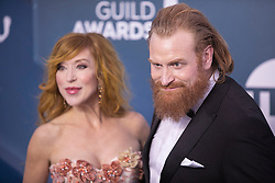 March 16, 2020, Los Angeles, California, USA: (R) KRISTOFER HIVJU posted on Instagram that he was self-quarantining after testing positive for coronavirus. The 'Game of Thrones' actor is the latest celebrity to say he's been diagnosed with the coronavirus. Kristofer played Tormund Giantsbane on the HBO series,  tested positive for Covid-19. The Norwegian actor, said he and his family are self-isolating upon the news. 'We are in good health - I only have mild symptoms of a cold,' he wrote. 'There are people at higher risk for who this virus might be a devastating diagnosis, so I urge all of you to be extremely careful; wash your hands, keep 1,5 meters distance from others, go in quarantine; just do everything you can to stop the virus from spreading. Greetings from Norway! Sorry to say that I, today, have tested positive for COVID19, Corona virus. My familiy and I are self-isolating at home for as long as it takes. We are in good health - I only have mild symptoms of a cold. There are people at higher risk for who this virus might be a devastating diagnosis, so I urge all of you to be extremely careful; wash your hands, keep 1,5 meters distance from others, go in quarantine; just do everything you can to stop the virus from spreading. Together we can fight this virus and avert a crisis at our hospitals. Please take care of each other, keep your distance, and stay healthy! Please visit your country's Center for Disease Control's website, and follow the regulations for staying safe and protecting not just yourselves, but our entire community, and especially those at risk like the elderly and people with pre-existing conditions. The actor said he is currently in Norway. 'Together we can fight this virus and avert a crisis at our hospitals. Please take care of each other, keep your distance, and stay healthy!' he said. FILE PHOTO: January 19, 2020, Hollywood, CA, USA: Actors GRY MOLVAR HIVJU and (R) KRISTOFER HIVJU on the 2020 SAG Awards Red Carpet. (Credit Image: © J