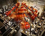 Robots assembling engine parts at volvo