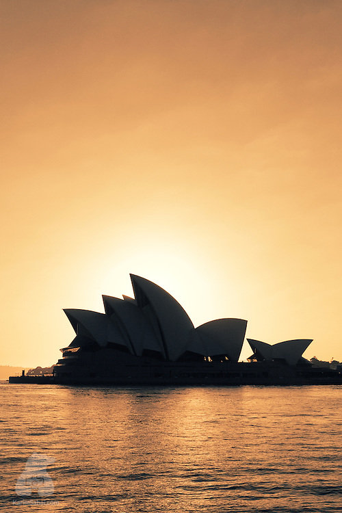 The Opera House silhouetted agains the rising sun, Sydney, Australia