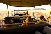 Touring in an open sided safari vehicle near the Sossus Dunes Lodge near the Sossusvlei Sand Dunes (highest dunes in the world), Namib Desert, Namib-Naukluft National Park, Namibia