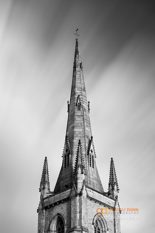 Low clouds streak past the spire of St Marie's church - Sheffield's Catholic Cathedral. A long exposure cityscape in black and white. October 2014.