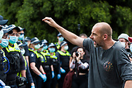 A man is seen yelling at police to stand down during the Melbourne Freedom Rally at The Shrine. Premier Daniel Andrews promises 'significant' easing of Stage 4 restrictions this weekend. This comes as only one new case of Coronavirus was unearthed over the past 24 hour and no deaths. (Photo by Dave Hewison/Speed Media)