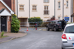 © Licensed to London News Pictures. 05/01/2020. Slough, UK. A Police officer along with equipment inside a cordon in Slough at a suspected murder scene, local residents reported that a teenage boy was stabbed on the evening of Saturday 4th January and rushed to Wexham Park hospital where he later died. Photo credit: Peter Manning/LNP