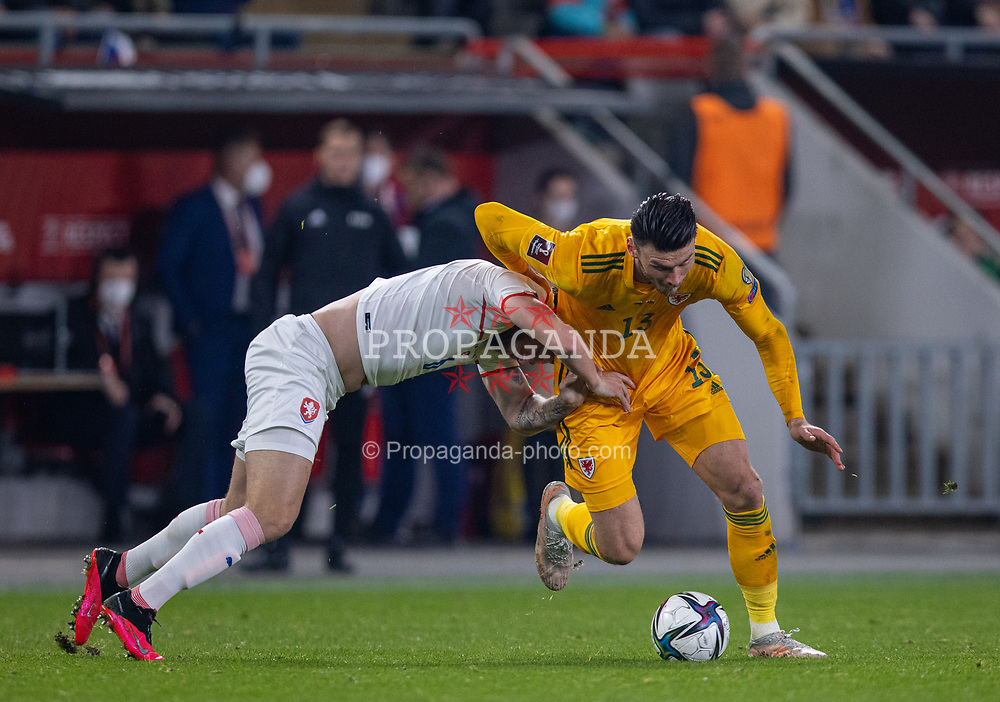 PRAGUE, CZECH REPUBLIC - Friday, October 8, 2021: Wales' Kieffer Moore (R) is pulled back by Czech Republic's Tomáš Kalas during the FIFA World Cup Qatar 2022 Qualifying Group E match between Czech Republic and Wales at the Sinobo Stadium. The game ended in a 2-2 draw. (Pic by David Rawcliffe/Propaganda)