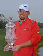 05APR15  JB Holmes with his trophy on the 18th green at the conclusion of Sunday's Final Round of The Shell Houston Open at The Golf Club of Houston in Humble, Texas. (photo credit : kenneth e. dennis/kendennisphoto.com)