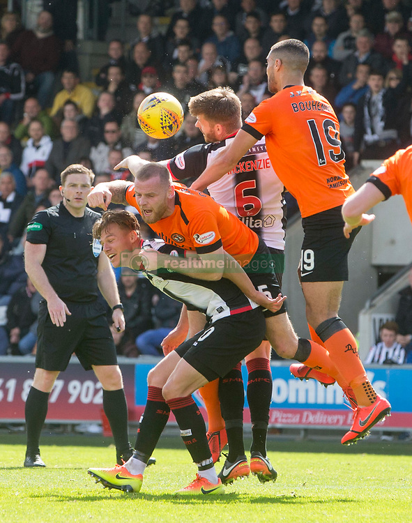 Dundee Utd Mark Connolly gets bundled over by St Mirren Gary Mackenzie during the Ladbrokes Premiership play-off final, second leg match at the Simple Digital Arena, St Mirren.