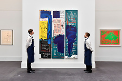 """© Licensed to London News Pictures. 23/06/2017. London, UK. Technicians view """"Untitled"""", 1983, by Jean-Michel Basquiat (estimate GBP4-6m) at the preview of Sotheby's Contemporary Art Sale in New Bond Street.  The auction, which is dominated by Pop art, takes place on 28 June. Photo credit : Stephen Chung/LNP"""