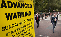 © Licensed to London News Pictures. 21/09/2020. London, UK. Chief Medical Officer for England Chris Whitty walks with Chief Scientific Adviser, Sir Patrick Vallance (R) near a sign giving advanced warning of road closures during the up coming London Marathon after they appeared in a televised press conference in Downing Street on the rise of Coronavirus infections. The Prime Minister is expected to announce new measures this week to curb the spread of the Coronavirus and halt a second wave of infections. Photo credit: Peter Macdiarmid/LNP