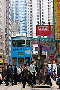 Pedestrians and tram in old Chinese district, Des Voeux Road, Sheung Wan, Hong Kong Island, China