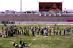 KABUL 25 August 2005..Athletes gather for the closing ceremony of the Olympics Games at Ghazi Stadium. In the background Gen. Massod is pictured in a billboard...On 23-25 August 2005, Special Olympics Afghanistan held its first national Games at Olympic Stadium in Kabul. ..More than 300 athletes, including 80 female athletes, experienced a taste of happiness and achievement for the first time in their lives. They competed in athletics, bocce and football (soccer). Because of cultural restrictions, males and females competed at separate venues...