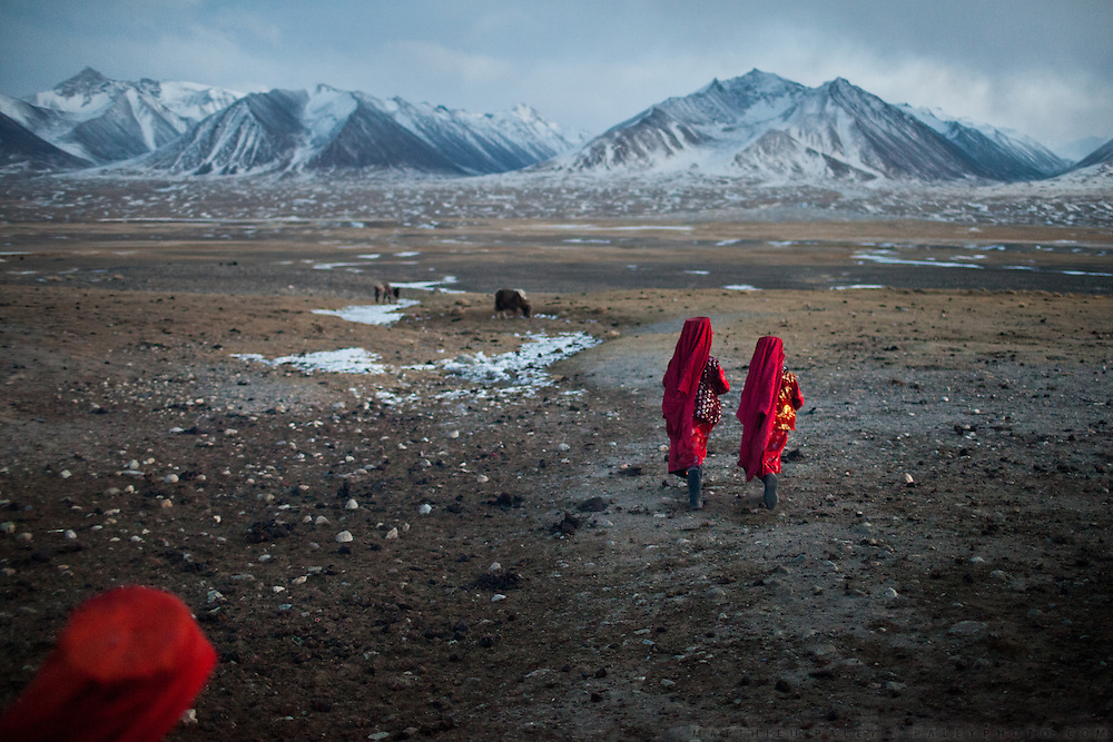 At dusk, two Kyrgyz girls, Toorkhan Bubu and sister Tumar Bubu,  walk away from camp, looking for a stray yak. At the Andemin camp...Trekking through the high altitude plateau of the Little Pamir mountains, where the Afghan Kyrgyz community live all year, on the borders of China, Tajikistan and Pakistan.