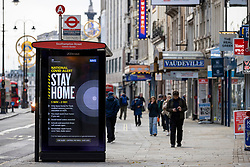 © Licensed to London News Pictures. 25/11/2020. London, UK. An advert advising people to stay at home because of the ongoing national lockdown is displayed on a bus stop on The Strand in central London. The government has announced that tiered restrictions will be reintroduced when the England-wide lockdown ends on 2 December. Photo credit: Rob Pinney/LNP