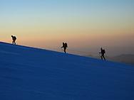 Climbers heading towards Lyskamm at dawn, from the Quintina Sella Hut, Italy