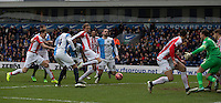 Stoke City's Peter Crouch shoots past Blackburn Rovers' Simon Eastwood to score his sides opening goal<br /> <br /> Photographer Stephen White/CameraSport<br /> <br /> Football - The FA Cup Fifth Round - Blackburn Rovers v Stoke City - Saturday 14th February 2015 -  Ewood Park - Blackburn<br /> <br /> © CameraSport - 43 Linden Ave. Countesthorpe. Leicester. England. LE8 5PG - Tel: +44 (0) 116 277 4147 - admin@camerasport.com - www.camerasport.com
