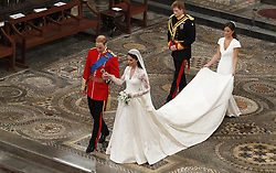 File photo dated 29/4/2011 of Prince William and his bride, Kate, followed by best man, Prince Harry, and maid of honour, Pippa Middleton, leave Westminster Abbey in London, following their wedding service.