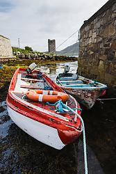 Boats at low tide near Kildownet Castle, Achill Island, County Mayo, Ireland