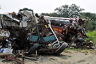 The wreckage of two buses involved in a head on collision that killed 27 people. After decades of war South Sudan's roads and infrastructure are in ruin..Pageri, South Sudan. 02/07/2011..Photo © J.B. Russell