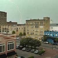 Lighting lit up the sky over Post Office St in Galveston as severe weather passed through the area, 08/09/03.(Photo by Kim Christensen)