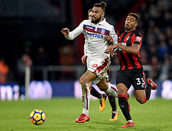 Stoke City's Eric Maxim Choupo-Moting (left) and AFC Bournemouth's Jordon Ibe battle for the ball during the Premier League match at the Vitality Stadium, Bournemouth.
