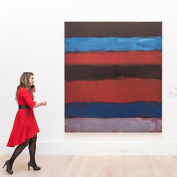 "© Licensed to London News Pictures. 01/03/2019. LONDON, UK. A visitor walks by ""Landline Red Blue"", 2015, by Sean Scully, (Est. £700,000 - 1,000,000).  Preview of Sotheby's Contemporary Art Sale in their New Bond Street galleries.  Works by artists including Tracey Emin, Jenny Saville, Jean-Michel Basquiat and Andy Warhol will be offered for auction on 5 March 2019.  Photo credit: Stephen Chung/LNP"
