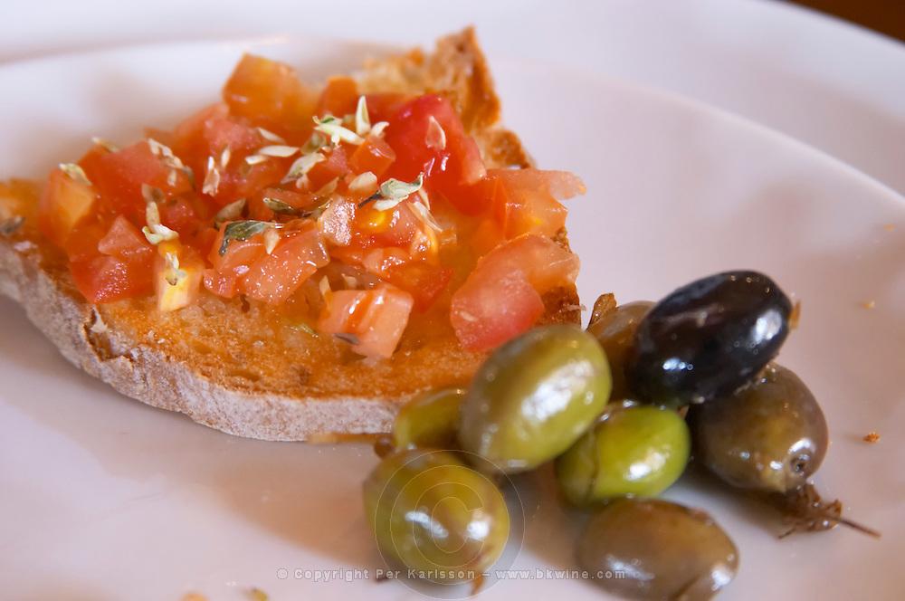 In the restaurant. Tomato on bread. Olives. Herdade da Malhadinha Nova, Alentejo, Portugal