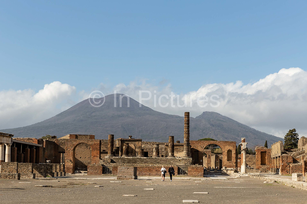 A couple walk through the almost-deserted Forum at the Pompeii Archeological Park on Friday 6th March 2020 in Pompei, Italy. Park officials estimate that visitor numbers are down to a sixth of what they would normally be as a result of the spread of Coronavirus, which has prompted the closure of all Italian schools and universities, and the postponing of many sporting events. .