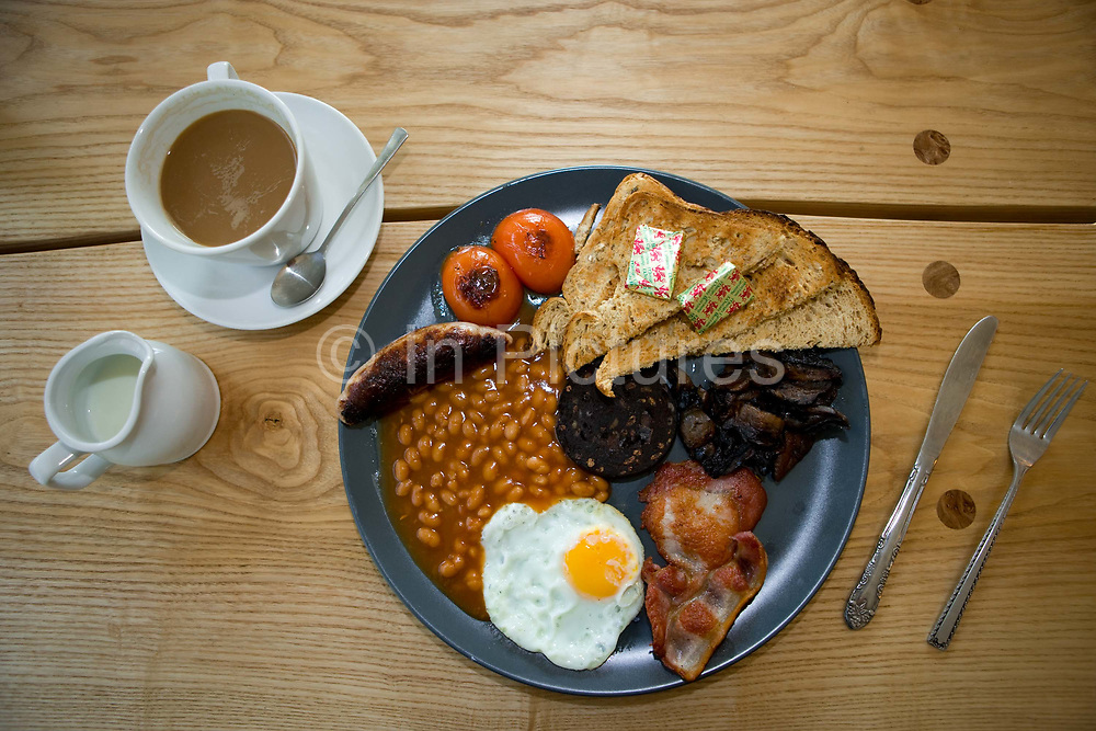 A traditional English breakfast with coffee and milk at Conwy Falls Cafe on the 19th April 2011 in Betws-y-coed in the United Kingdom.