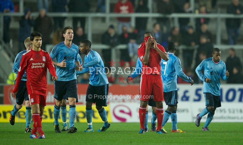 ST HELENS, ENGLAND - Wednesday, March 14, 2012: Liverpool's Andre Wisdom looks dejected as Ajax score the fourth goal during the NextGen Series Semi-Final match at Langtree Park. (Pic by David Rawcliffe/Propaganda)