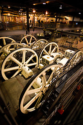 California, San Francisco: Cable Car transportation. Large wheels turn cables at Cable Car Barn. Photo 5-casanf77969. Photo copyright Lee Foster.