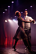 Couples dancing in the 'Tango Roja' tango show performance in the Faena Hotel, Buenos Aires, Federal District, Argentina.
