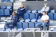 Queens Park Rangers Director of Footbal Les Ferdinand (front left) and Queens Park Rangers Chief Executive Officer CEO Lee Hoos (white shirt) during the EFL Sky Bet Championship match between Queens Park Rangers and Barnsley at the Kiyan Prince Foundation Stadium, London, England on 20 June 2020.