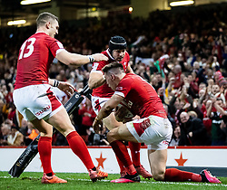 Josh Adams of Wales celebrates scoring his sides first try<br /> <br /> Photographer Simon King/Replay Images<br /> <br /> Six Nations Round 1 - Wales v Italy - Saturday 1st February 2020 - Principality Stadium - Cardiff<br /> <br /> World Copyright © Replay Images . All rights reserved. info@replayimages.co.uk - http://replayimages.co.uk