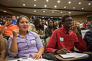 Purchase, NY – 31 October 2014. Kimberly Chavarria and Samuel Brown, members of the team from Port Chester High School, watch as Gorton High School presents.The Business Skills Olympics was founded by the African American Men of Westchester, is sponsored and facilitated by Morgan Stanley, and is open to high school teams in Westchester County.