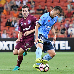 BRISBANE, AUSTRALIA - NOVEMBER 19: Bobo of Sydney and Tommy Oar of the Roar compete for the ball during the round 7 Hyundai A-League match between the Brisbane Roar and Sydney FC at Suncorp Stadium on November 19, 2016 in Brisbane, Australia. (Photo by Patrick Kearney/Brisbane Roar)