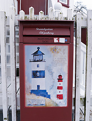 Mailbox outside house with painted lighthouses in Kladesholmen on Bohuslan coast in Sweden